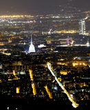 Aerial view of Turin with the illuminated symbol of the city Royalty Free Stock Images
