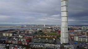 Aerial View of Turning Torso Skyscraper in Sweden. Malmo, Sweden - July 28, 2017: Aerial view of the west harbor area with the Turning Torso skyscraper stock video footage