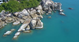 Aerial View of Turquoise Lagoon with Big Rocks stock video