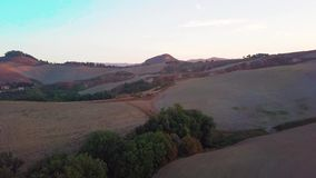 Aerial view of tuscany cultivated hills at sunrise val d`orcia. Aerial view of Italy. Drone shoot stock footage
