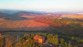 Aerial view of tuscany cultivated hills at sunrise val d`orcia. Aerial view of Italy. Drone shoot stock video