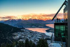 Aerial sunset view of Queenstown and The Remarkables mountain, New Zealand royalty free stock images