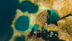 Aerial view Twin lagoon, sea, beach. Tropical island. Busuanga, Palawan, Philippines. Aerial view: Twin Lagoon with blue, azure water in the middle of small stock video