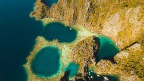 Aerial view Twin lagoon, sea, beach. Tropical island. Busuanga, Palawan, Philippines. Aerial view: Twin Lagoon with blue, azure water in the middle of small Royalty Free Stock Photos