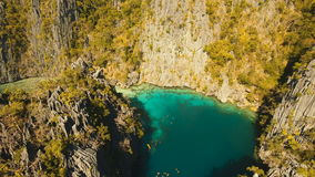 Aerial view Twin lagoon, sea, beach. Tropical island. Busuanga, Palawan, Philippines. Aerial view: Twin Lagoon with blue, azure water in the middle of small stock footage
