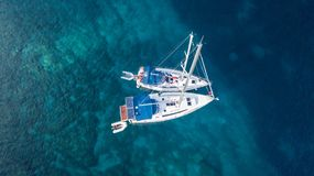 Aerial view of two anchoring yacht in open water. stock photography