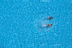 Aerial view of a two girls swimming in the pool Stock Image