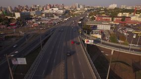 Aerial view of two-level road junction in the big city. Sunset filming. Busy roads and many cars in Kiev city stock video footage