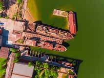 Aerial view, two old, rusty barges, moored at the pier on river Royalty Free Stock Image