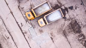 Aerial view of two orange trucks. in front of warehouse. Royalty Free Stock Photo
