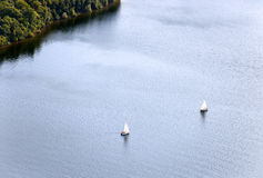 Aerial View : two sailboats isolated on a lake Stock Image