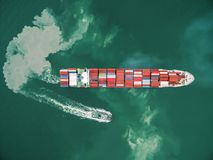 Aerial view two tug boat towing cargo container in warehouse har Royalty Free Stock Photography