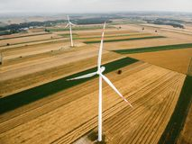 Aerial view of two windmills against cloudy sky Royalty Free Stock Photos