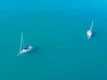 Aerial view of two yachts sailling on azure water. Beautiful aerial view of two yachts sailling on azure water Stock Images