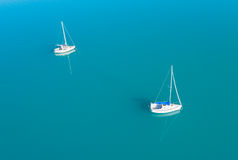 Aerial view of two yachts sailling on azure water. Beautiful aerial view of two yachts sailling on azure water Stock Photography