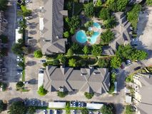 Typical green apartment living and swimming pool in Texas, USA. Aerial view of typical multi-level apartment building complex with swimming pool, surrounded by stock images