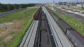 Aerial view UHD 4K of freight train with wagons and standing train with coal. On summer day stock video
