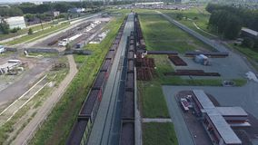 Aerial view UHD 4K of freight train with wagons and standing train with coal. On summer day stock video footage