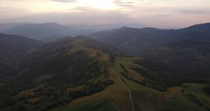Aerial View Ukraine. Sunevyr. Flight over the Mountains. Flying over the Trees. Forest Valley. Sunset day. 4K resolution. Aerial View Ukraine. Sunevyr. Flight stock video footage