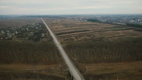 Aerial view: Ukrainian fields and houses, roads and pool stock video