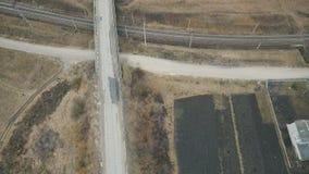 Aerial view: Ukrainian roads, bridge, track, fields in village stock video footage