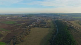 Aerial view of the Ukrainian village and field stock video footage