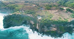 Aerial view of Uluwatu cliffs in Bali. Aerial drone view of temple and beautiful Uluwatu cliffs in Bali, Indonesia stock video footage