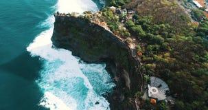 Aerial view of Uluwatu cliffs in Bali. Aerial drone view of temple and beautiful Uluwatu cliffs in Bali, Indonesia stock video