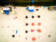 Aerial view of umbrellas in beach, Brazil Royalty Free Stock Image