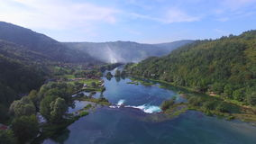 Aerial view of Una river waterfalls and green forested landscape, Bosnia stock video footage