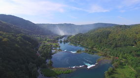 Aerial view of Una river waterfalls and green forested landscape, Bosnia stock video