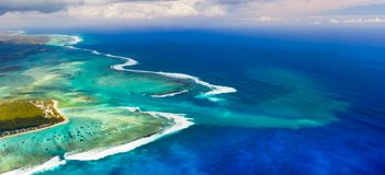 Aerial view of the underwater waterfall. Mauritius. Panorama royalty free stock photos