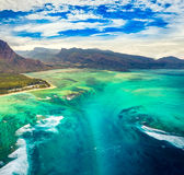 Aerial view of the underwater waterfall. Mauritius. Aerial view of the underwater waterfall. Amazing Mauritius landscape Royalty Free Stock Image