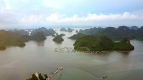 Aerial View UNESCO World Heritage Site Ha Long Bay Islands. Aerial view UNESCO world heritage site Ha Long bay washes small islands in Vietnam province stock footage
