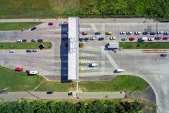 Aerial view of unpaved natural parking with lots of trucks, trailers and cars. Rest place near road and circle junction royalty free stock photography