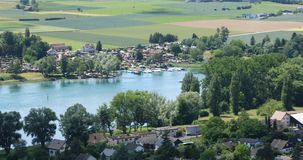 Rhine river, aerial view. Aerial view of the upper Rhine valley on the Swiss – German border near the city of Stein am Rhein on a beautifully sunny late spring stock video