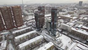 An aerial view of an urban landscape covered with snow stock video