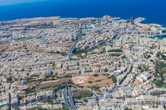 Aerial view of urban Malta. Tunnel on highway 1 under Ta ` Giorni town and Paceville district, parts of St. Julian`s San Giljan stock photo