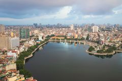 Aerial view of urban skyline at twilight. Hanoi cityscape. Dong Da lake view Royalty Free Stock Images