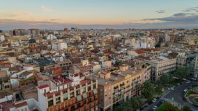 Aerial view of Valencia, Spain in the evening. Plaza de la Reina with many cafes and restaurants, very popular among tourists. Cloudy colorful sky. Time-lapse stock video footage
