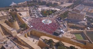 Aerial view of the Valletta city. Celebrating Labour party. Thousands of people walking down the streets of the old town in Valetta, Malta stock video footage