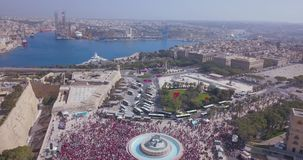 Aerial view of the Valletta city celebrating Labour party. Thousands of people walking down the streets of the old town in Valetta, Malta stock footage