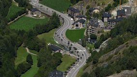 Andorra from above.Fixed plane. Aerial view of the  valley bottom of `Ordino` with green meadows and main road traffic  in stock footage