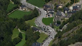 Andorra from above.Time Lapse.Fixed plane. Aerial view of the  valley bottom of `Ordino` with green meadows and main road traffic  in stock footage