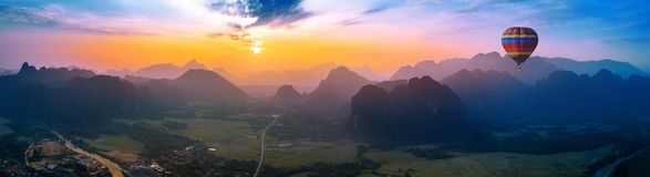 Aerial view of Vang vieng with mountains and balloon at sunset royalty free stock photos