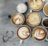 Aerial view of various coffee cups Royalty Free Stock Photos