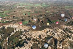 aerial view of various colorful hot air balloons flying above cappadocia, turkey royalty free stock photo