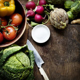 Aerial view of various fresh vegetable with knife and wooden cutting board Royalty Free Stock Photos
