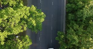 Aerial Drone Flight top down View of freeway busy city rush hour heavy traffic jam highway. Aerial view of the vehicular intersection, traffic at peak hour with stock footage