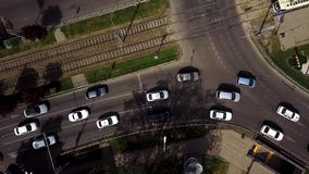 Top down street view of freeway busy city rush hour heavy traffic jam highway and tram way. Aerial view of the vehicular intersection, traffic at peak hour with stock footage